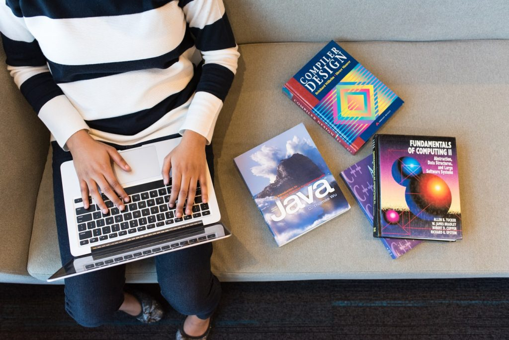 woman studying IT lessons while using compute