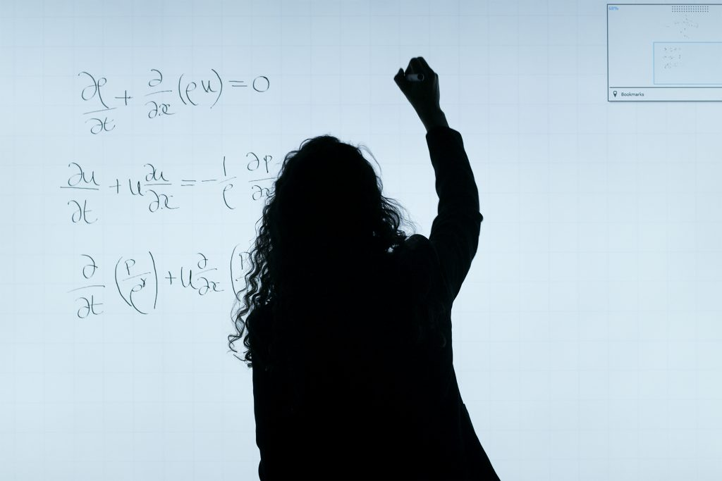 lady writing on the board